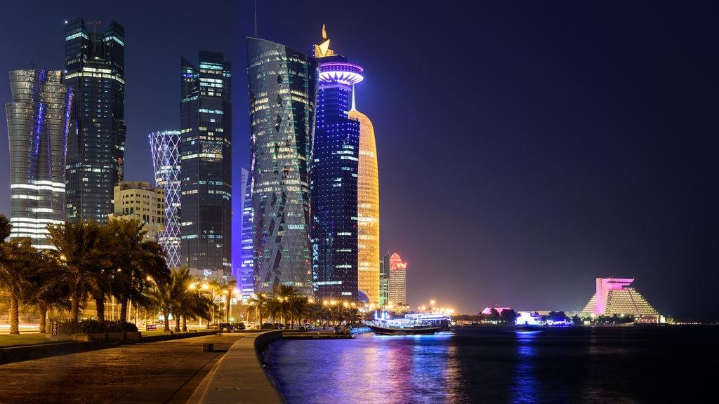 Doha Corniche which includes a city, a bay or harbor and night scenes