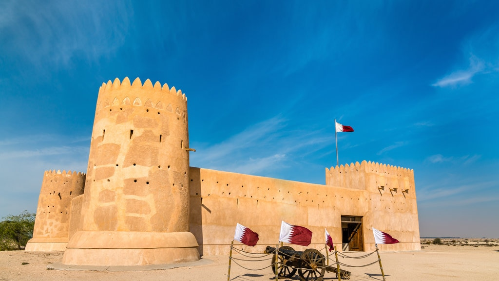 Al Zubarah Archaeological Site showing heritage architecture and a castle