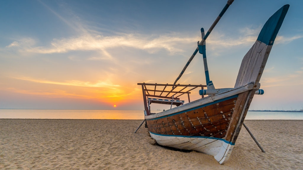 Al Wakrah Beach which includes boating, general coastal views and a sandy beach