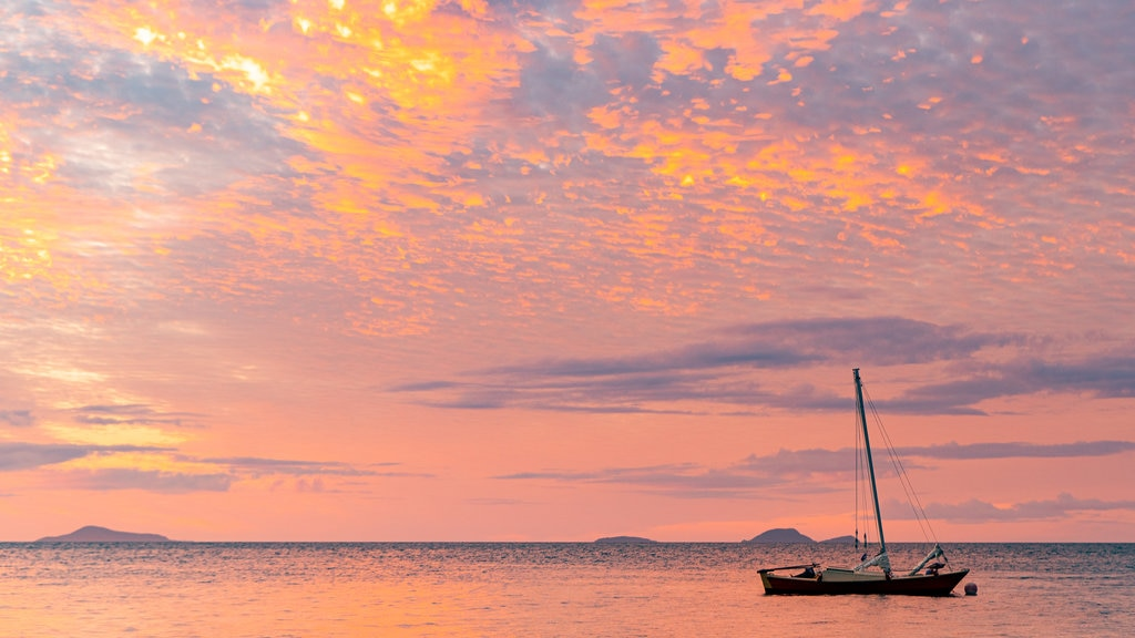 Whitsunday Islands featuring sailing, general coastal views and a sunset