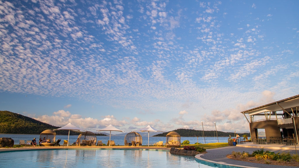 Daydream Island which includes a pool and a sunset