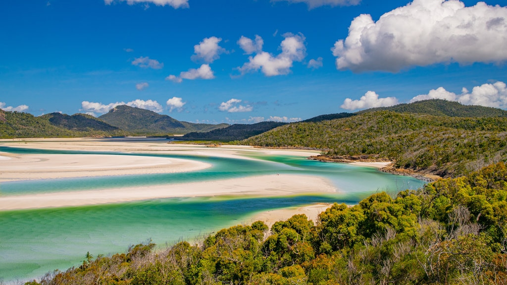 Whitehaven Beach which includes landscape views, a sandy beach and general coastal views