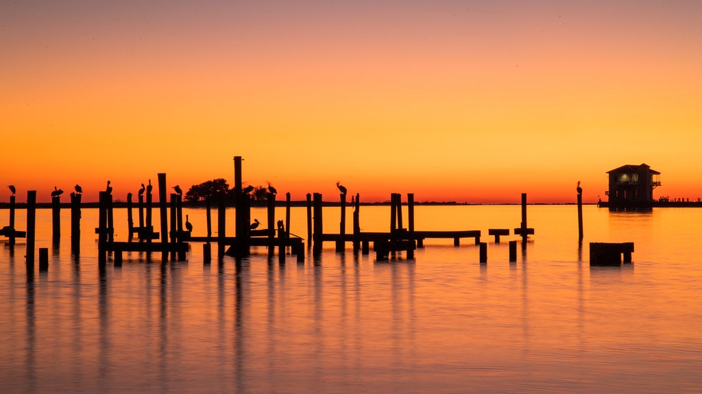Biloxi which includes a sunset and general coastal views