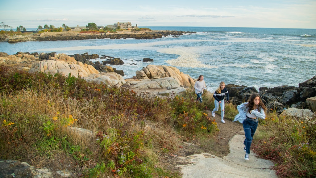 Bush Compound which includes rocky coastline and general coastal views as well as a small group of people