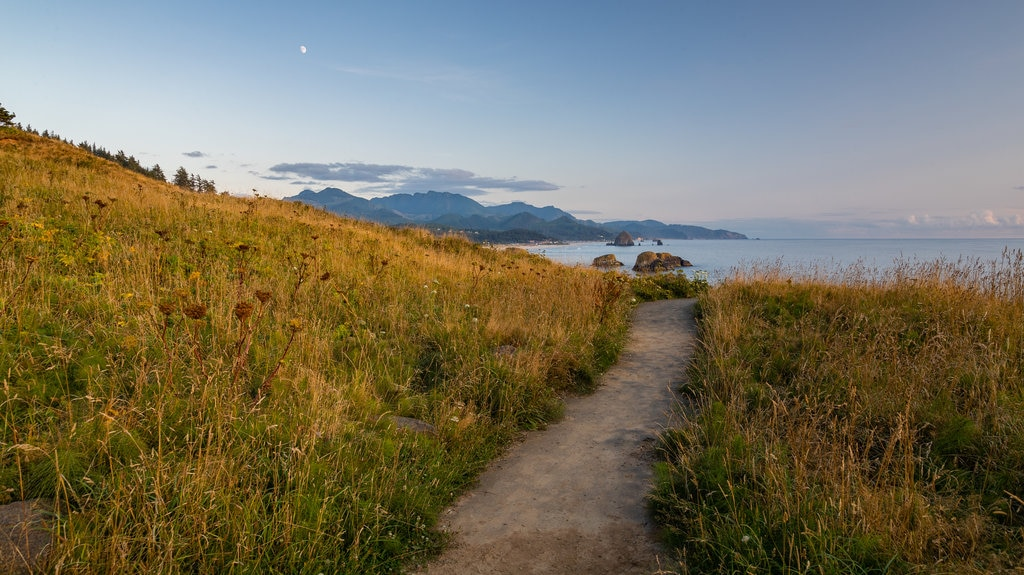 Ecola State Park which includes general coastal views, tranquil scenes and a sunset