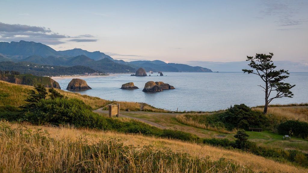 Ecola State Park which includes general coastal views, a sunset and tranquil scenes