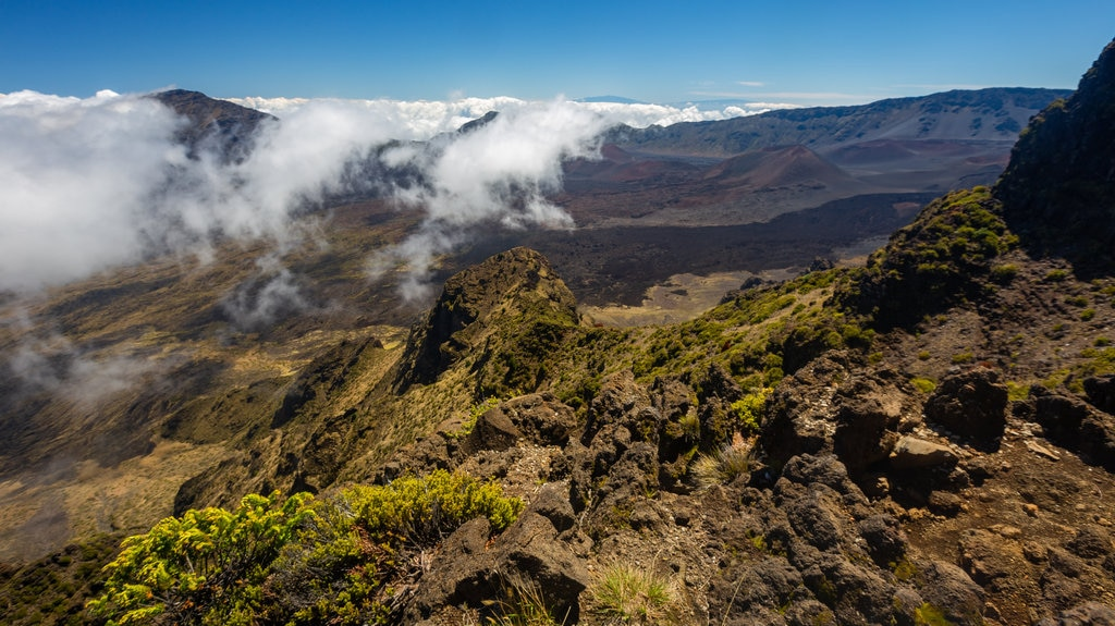 Haleakala National Park featuring mountains, mist or fog and landscape views