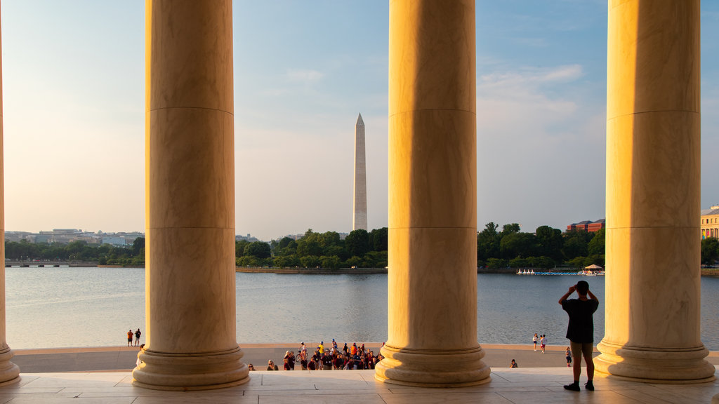Jefferson Memorial which includes a monument, a sunset and a lake or waterhole