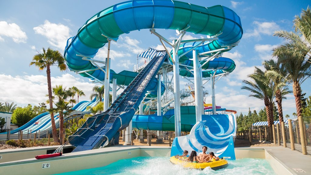 Knott\'s Berry Farm featuring a waterpark and swimming as well as a small group of people