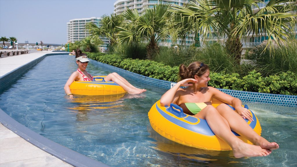 Orange Beach featuring a waterpark and watersports as well as an individual femail