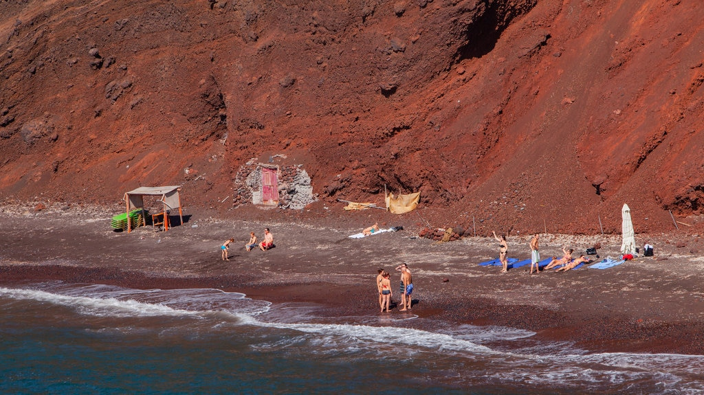 Santorini which includes rugged coastline and general coastal views as well as a small group of people