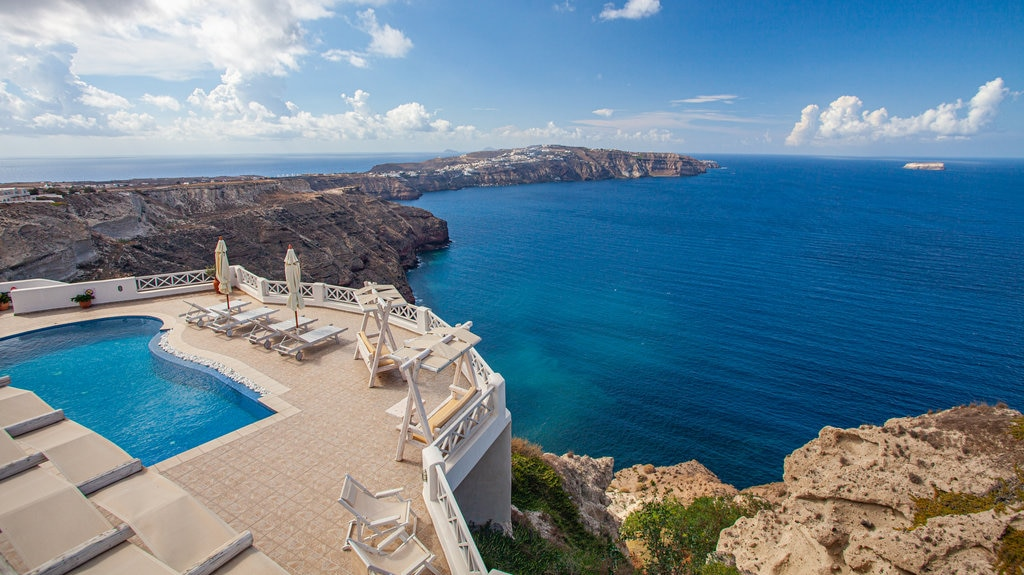 Santorini showing general coastal views, a pool and landscape views