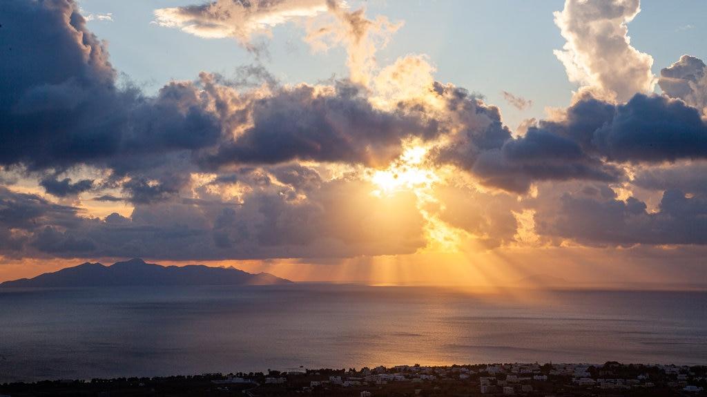 Santorini featuring general coastal views and a sunset