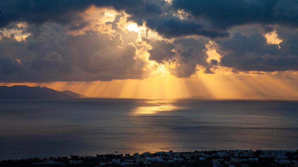 Santorini showing general coastal views and a sunset