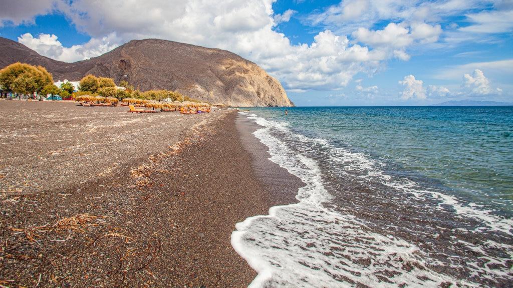 Santorini que incluye costa rocosa y vistas generales de la costa
