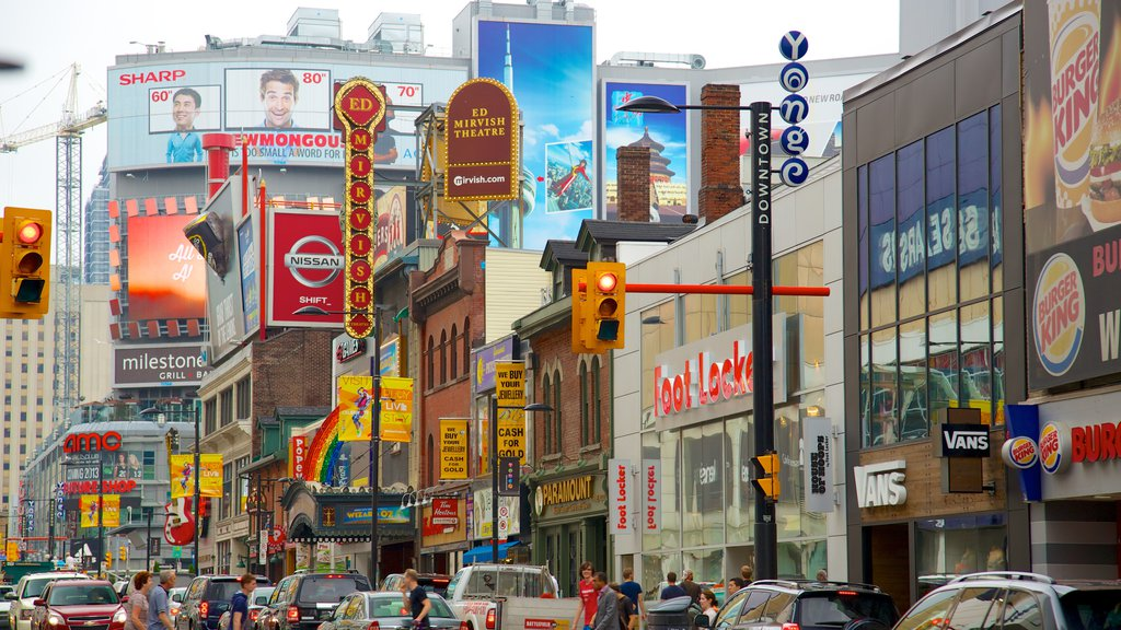 Yonge Street Shopping District showing street scenes, signage and a city