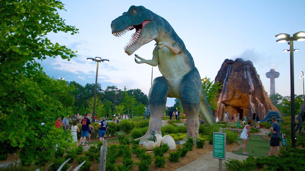 Niagara SkyWheel featuring outdoor art, a park and rides