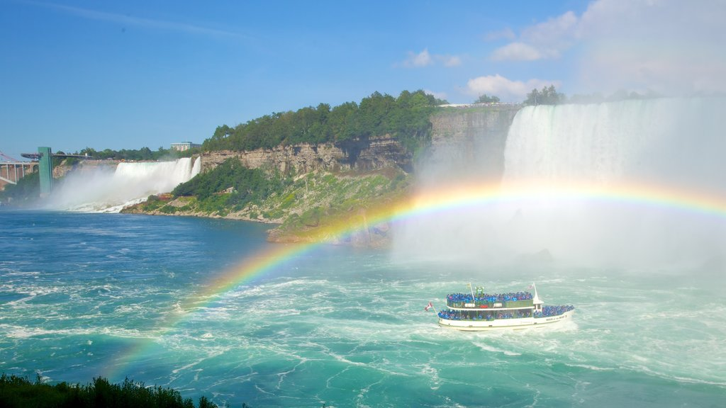 Journey Behind The Falls showing boating, a cascade and a ferry