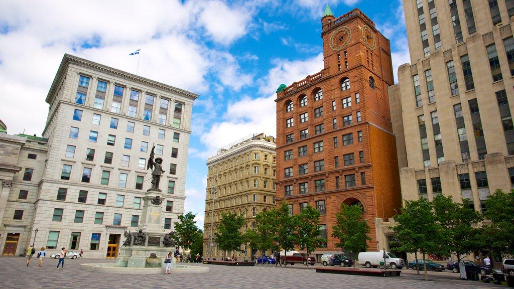 Casco antiguo de Montreal que incluye una estatua o escultura, un edificio administrativo y un monumento