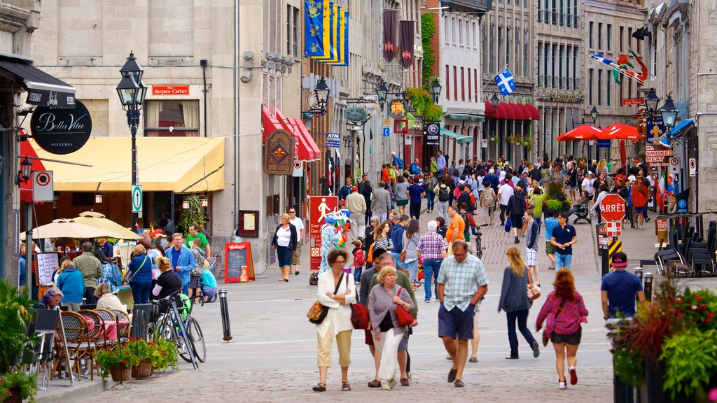 Old Montreal featuring a city and street scenes as well as a large group of people