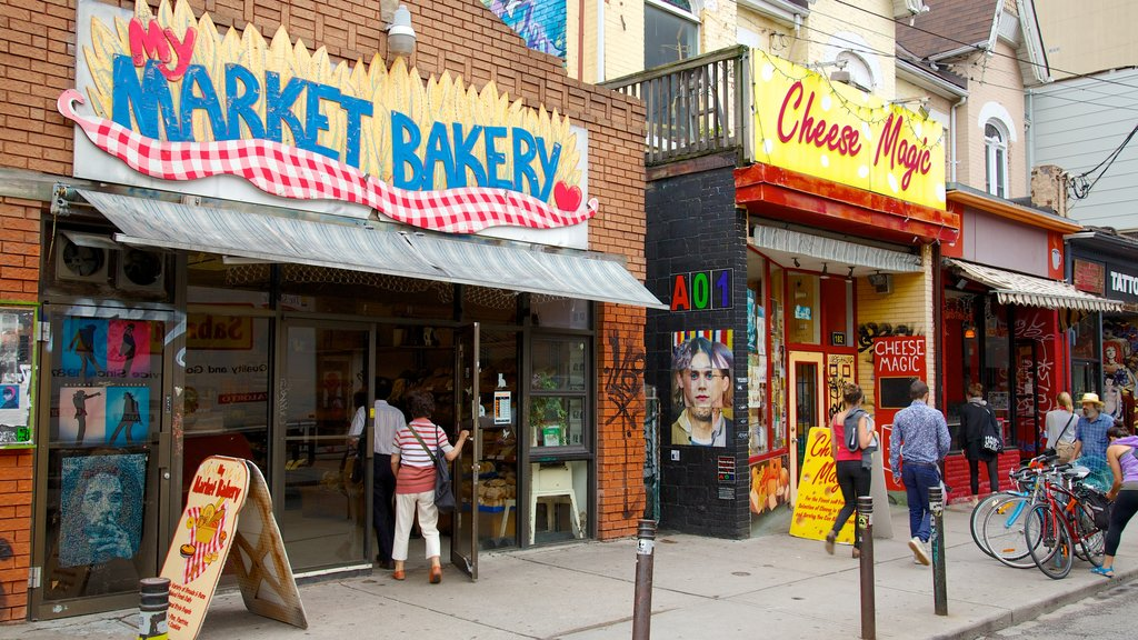 Kensington Market which includes markets, a city and signage
