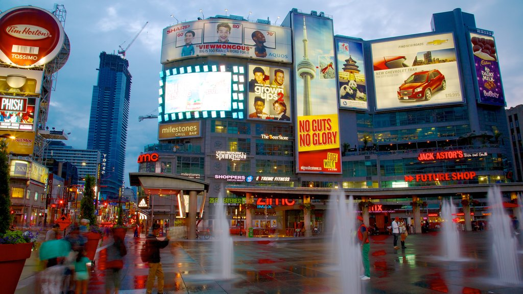 Yonge Street Shopping District showing night scenes, street scenes and a city
