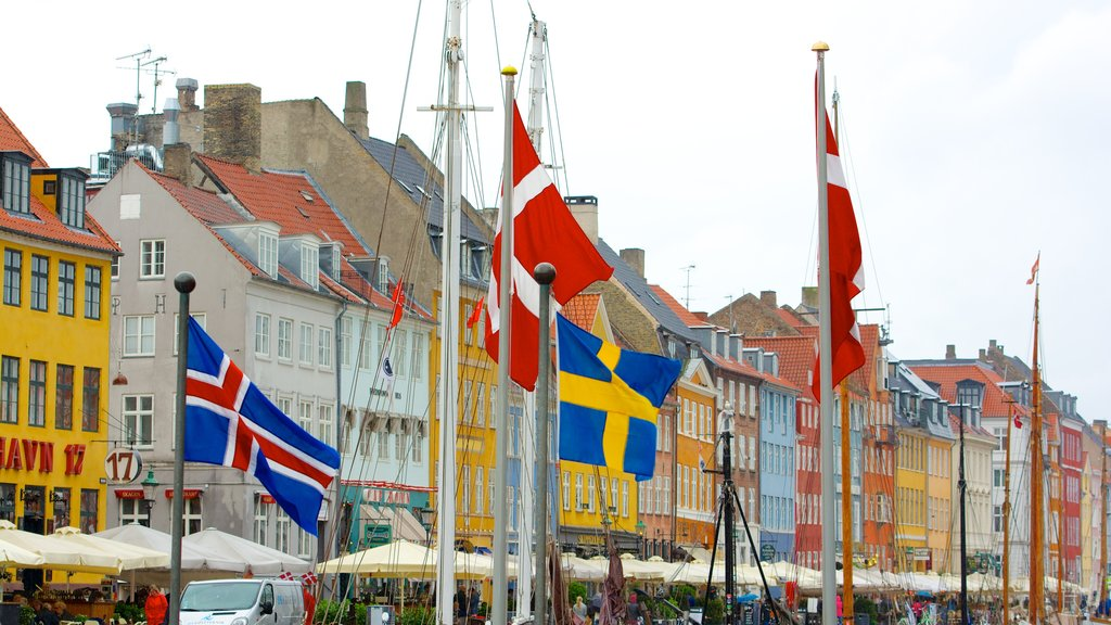 Nyhavn which includes heritage architecture and a city