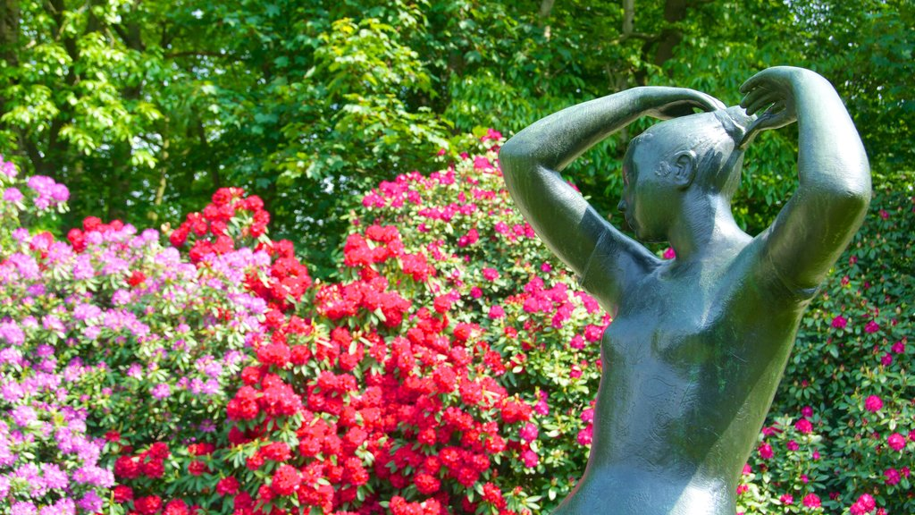 Middelheim Park which includes outdoor art, a statue or sculpture and flowers