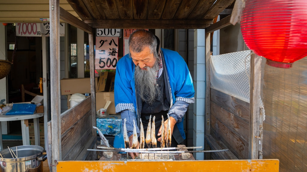 Kofu featuring markets and food as well as an individual male