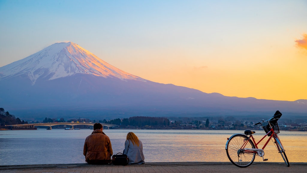 Mount Fuji showing mountains, a sunset and a lake or waterhole