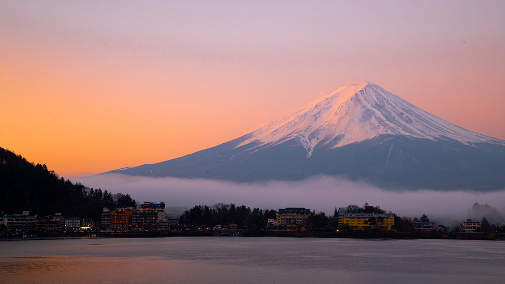 Mount Fuji which includes a sunset, mountains and snow