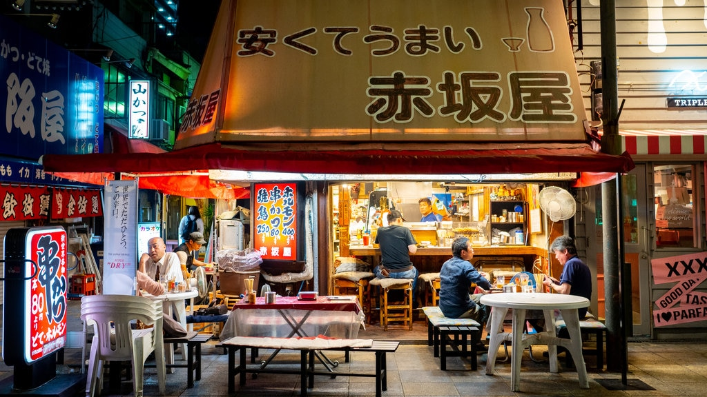 Shinsekai featuring night scenes, outdoor eating and street scenes