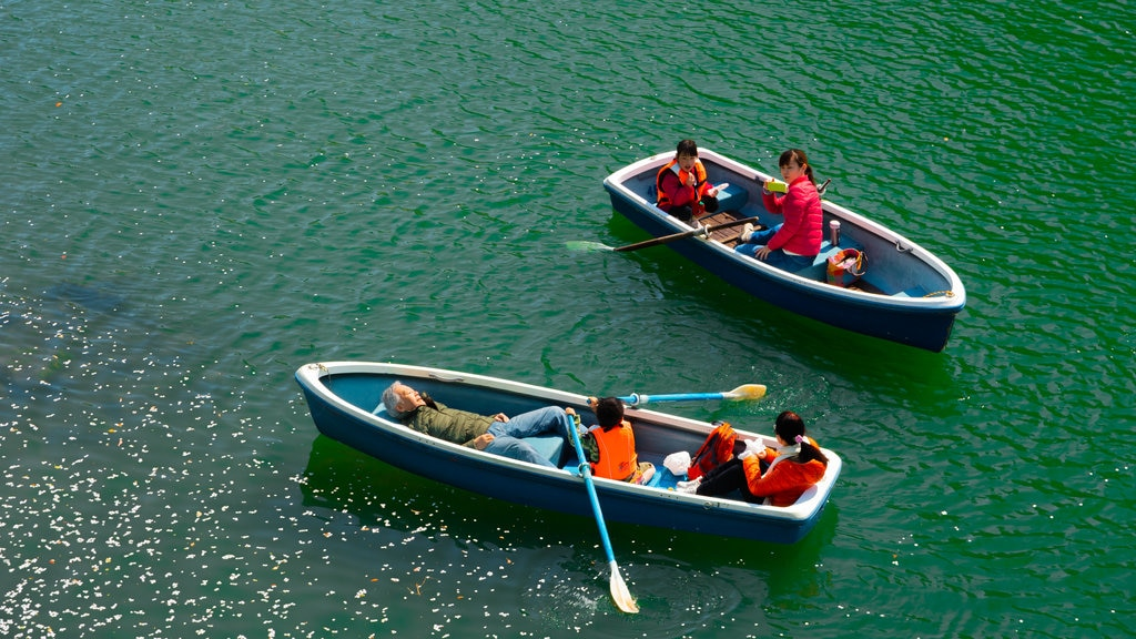 Chiyoda showing kayaking or canoeing as well as a family