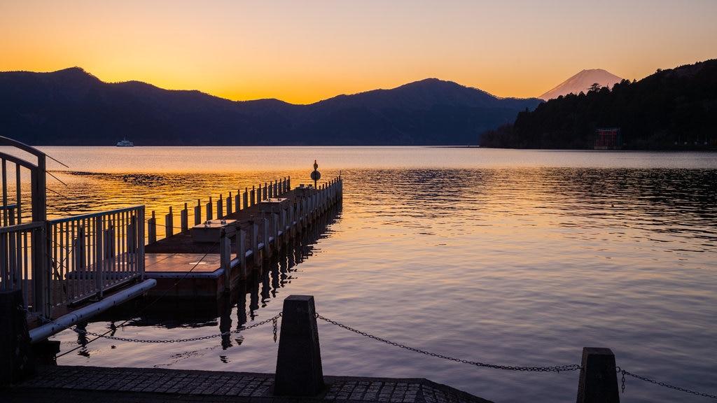 Lake Ashi featuring a sunset and a lake or waterhole