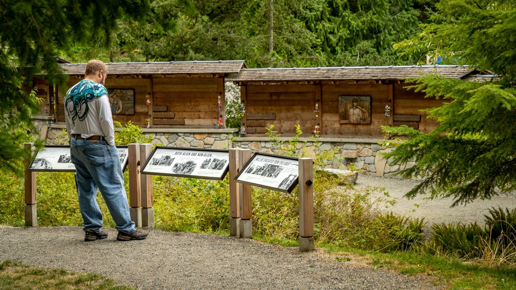 Bainbridge Island Japanese American Exclusion Memorial showing signage as well as an individual male