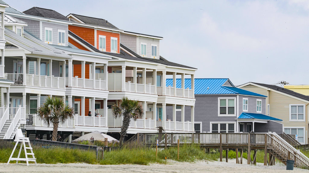 Coastal South Carolina which includes a coastal town, a house and a sandy beach