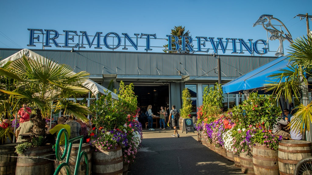 Fremont Brewing which includes flowers and signage as well as a small group of people