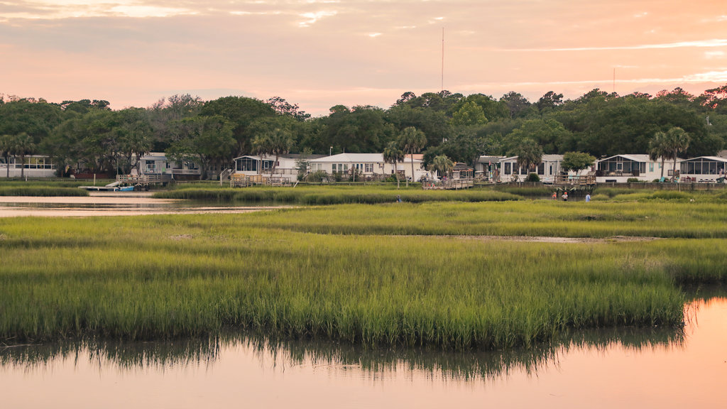 Murrells Inlet which includes a small town or village, wetlands and a sunset