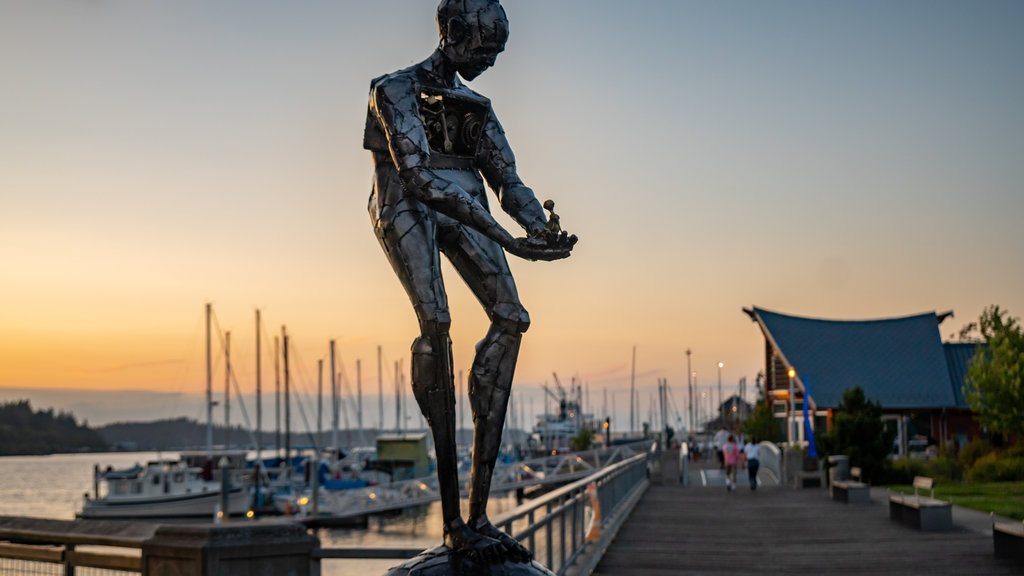 Percival Landing featuring a sunset, a bay or harbor and outdoor art