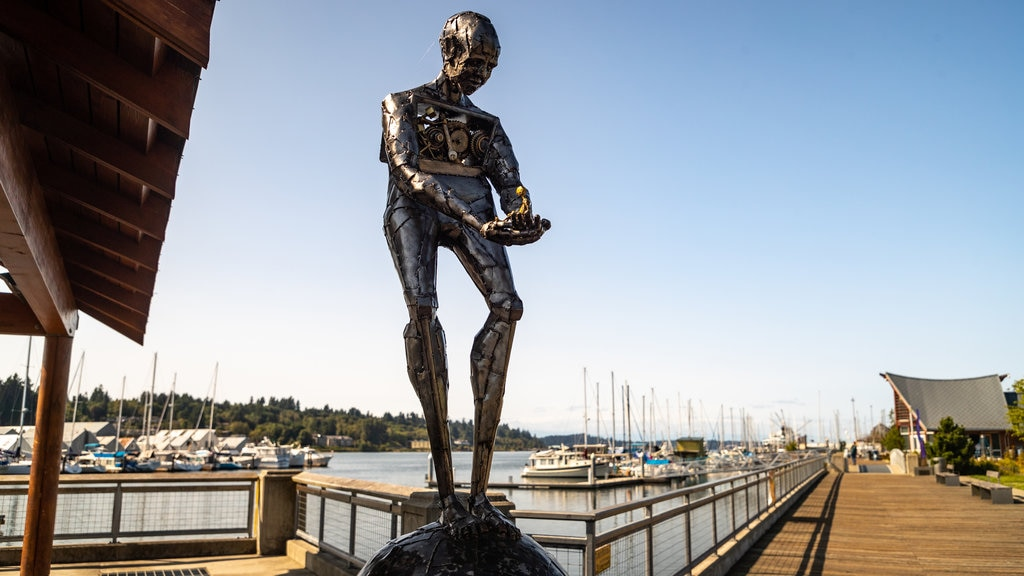 Percival Landing which includes outdoor art and a bay or harbor