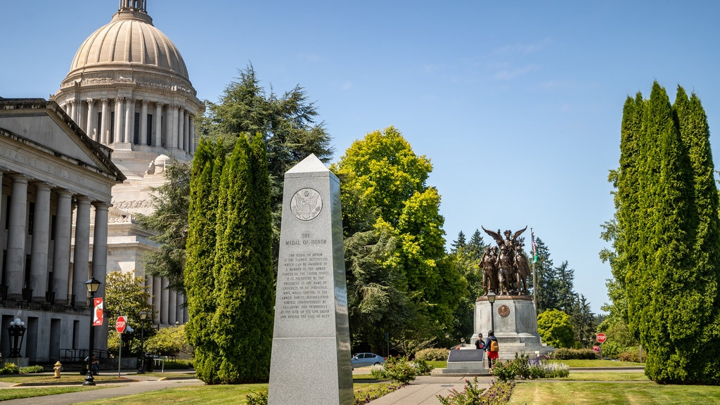 Washington State Capitol showing a garden, an administrative buidling and a statue or sculpture