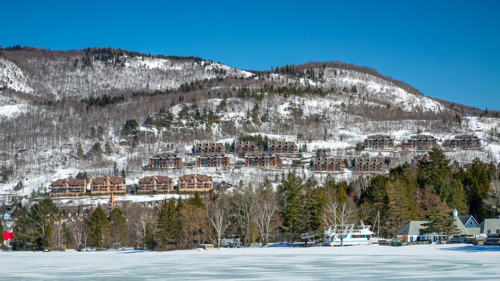 Lake Tremblant which includes a small town or village, landscape views and snow