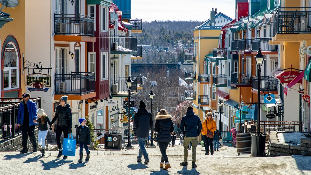 Mont-Tremblant Pedestrian Village featuring street scenes as well as a small group of people
