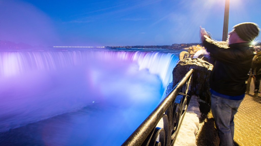 Niagara Falls , Canada which includes views, night scenes and a waterfall