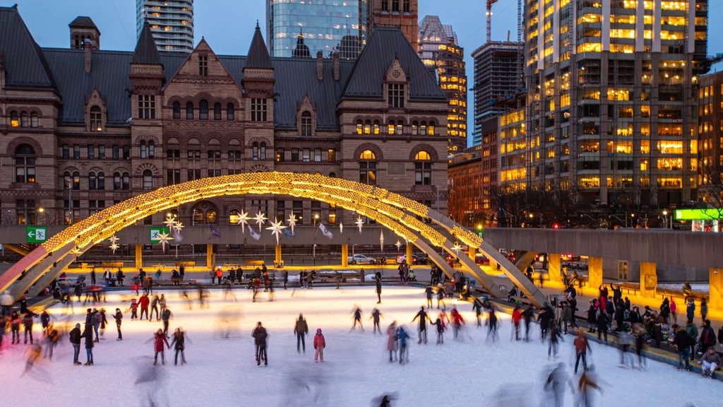Nathan Phillips Square which includes a city, night scenes and snow skiing