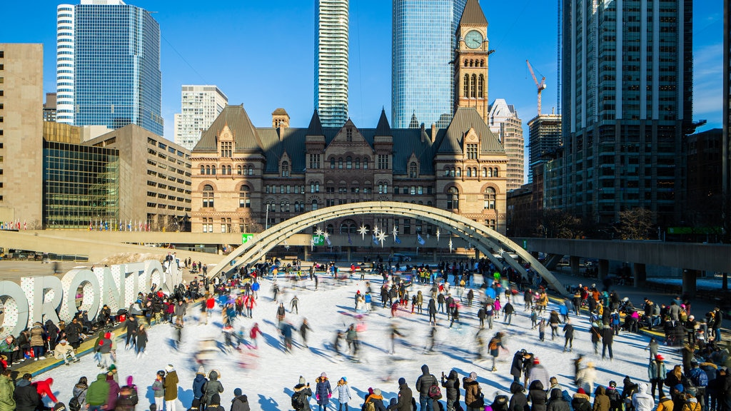 Nathan Phillips Square which includes a city and snow skiing as well as a large group of people