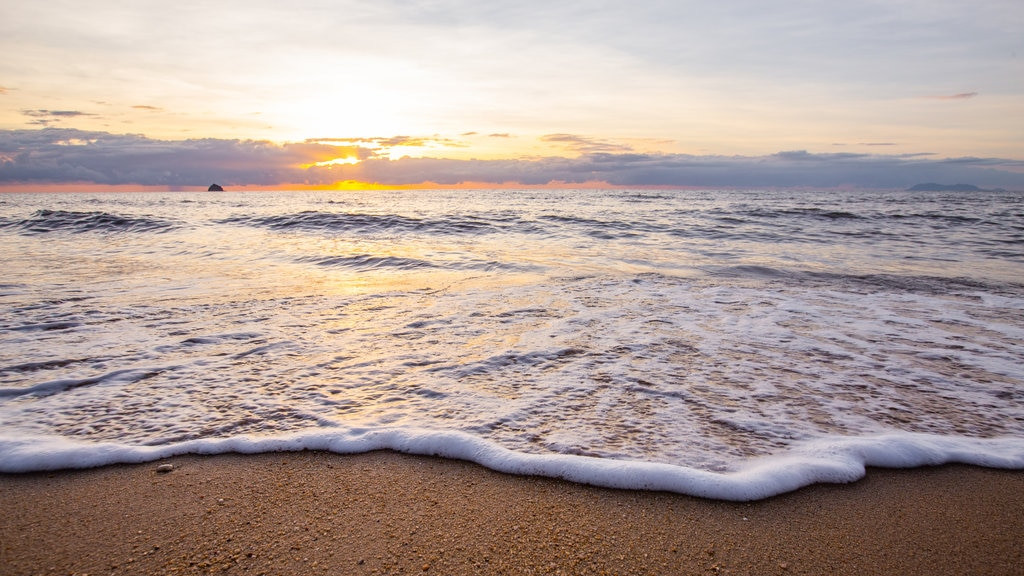 Tropical North Queensland which includes general coastal views, a sunset and a sandy beach