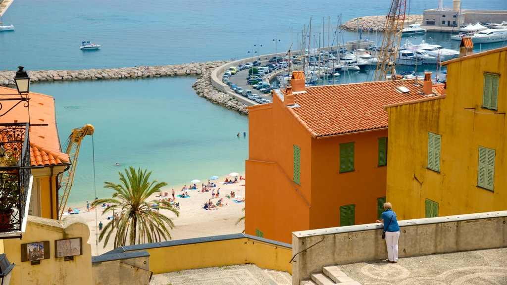 Menton featuring general coastal views and a coastal town as well as an individual femail