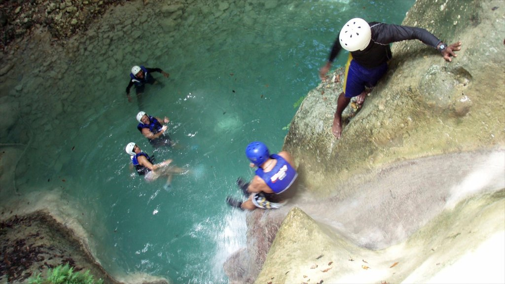 Dominican Republic featuring swimming, caving and a cascade
