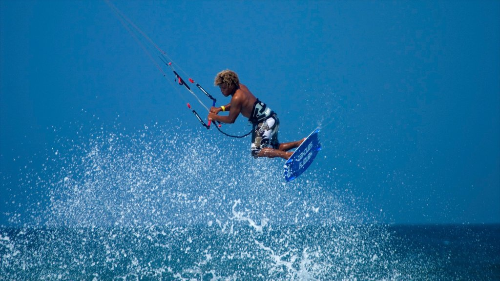 Cabarete showing waves and kite surfing as well as an individual male